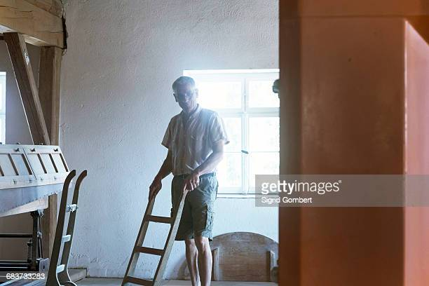 male miller pushing sack barrow in wheat mill - sigrid gombert stock pictures, royalty-free photos & images