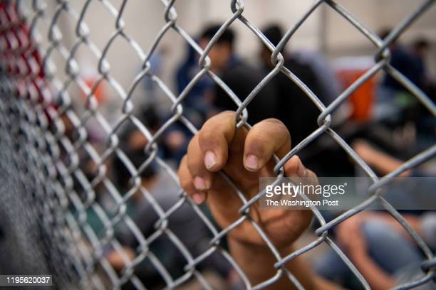 Male minors sit and wait inside the US Border Patrol Central Processing Center in McAllen, Texas on August 12, 2019. Border Patrol officials said...