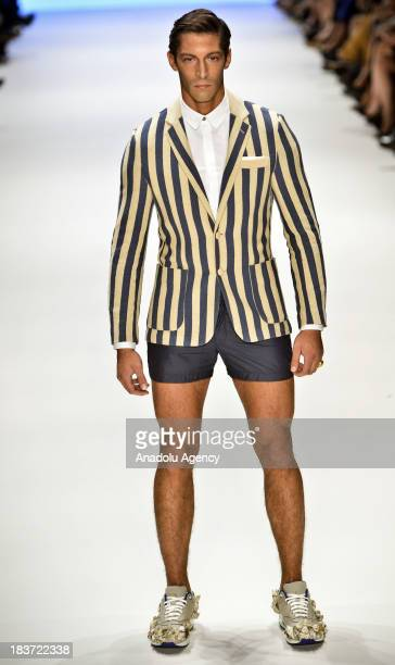 A male model displays a creation by Serdar Uzuntas on the 3rd day of MercedesBenz Fashion Week at Kurucesme Arena on October 9 2013 in Istanbul Turkey