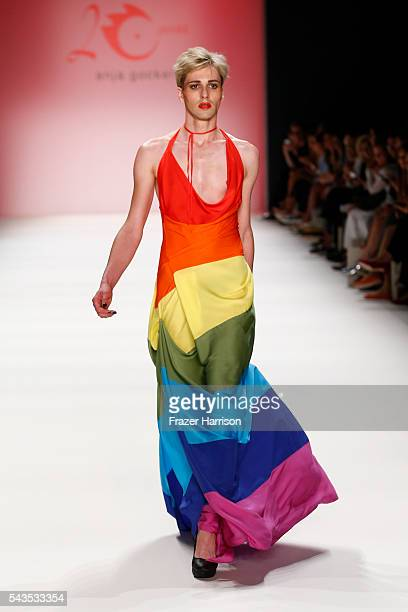 A male model dressed in a rainbow colour outfit walks the runway at the Anja Gockel show during the MercedesBenz Fashion Week Berlin Spring/Summer...
