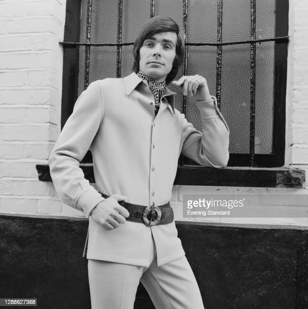 Male model in a belted tunic top, UK, June 1971.