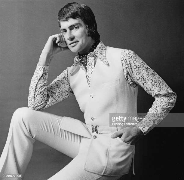 Male model in a patterned shirt, belted sleeveless jerkin and trousers, UK, June 1971.