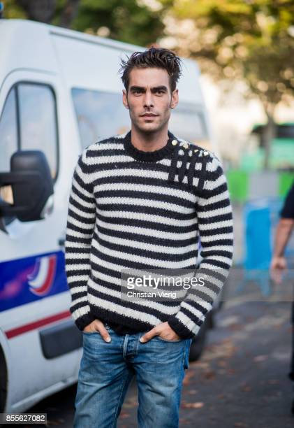 Male model Jon Kortajarena wearing stripped sweater is seen outside Loewe during Paris Fashion Week Spring/Summer 2018 on September 29 2017 in Paris...
