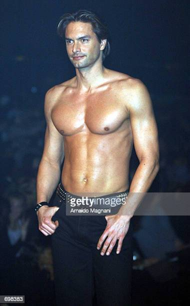 Male model Marcus Schenkenberg walks the runway during the Lane Bryant Lingerie Fashion Show February 5 2002 in New York City