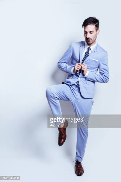 male model posing in a suit - evening wear stock pictures, royalty-free photos & images