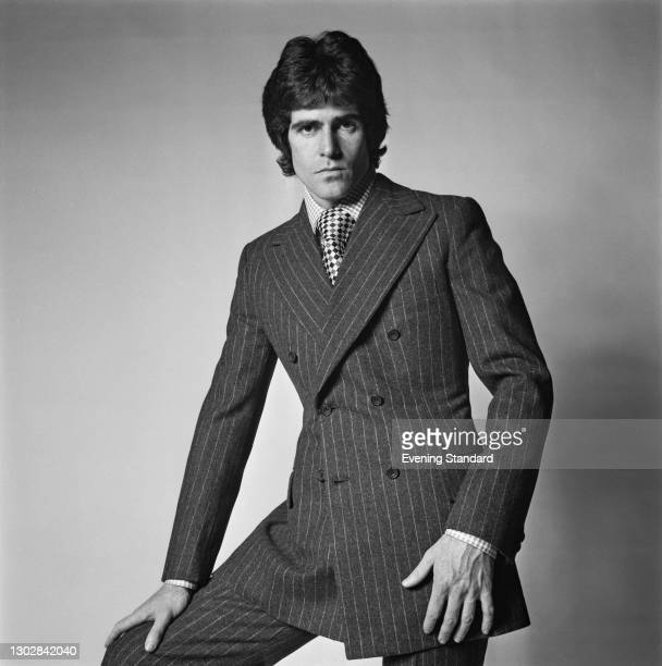 Male model wearing a double-breasted suit in a chalk pinstripe, UK, 20th September 1972.