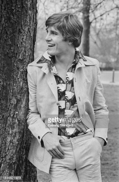 Male model wearing a patterned shirt and light-coloured jacket, UK, 3rd April 1974.