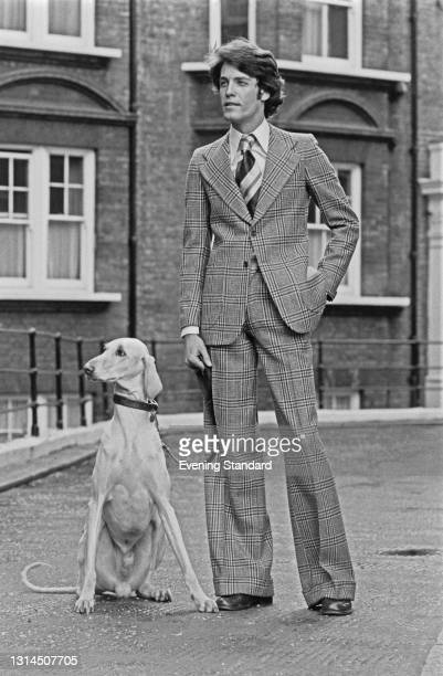 Male model wearing a tweed suit with wide-legged trousers, UK, 16th January 1974.