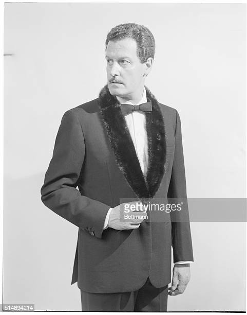 Male model wears a fur trimmed tuxedo designed by Brioni of Rome for a fashion show in Florence's Pitti Palace.