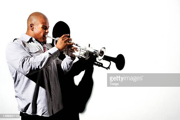 Male musician playing trumpet