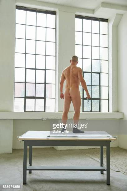 Male Nude Standing on Table Large Room