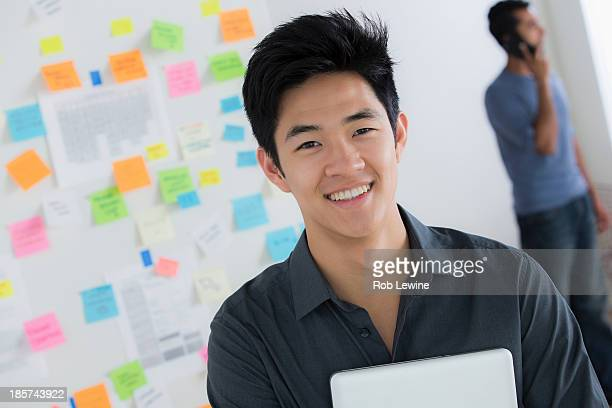Male office worker holding digital tablet