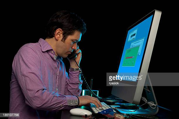 Male Office Worker On Phone At Computer Console Black Isolated