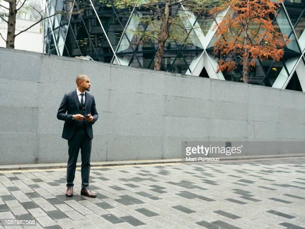 Male office worker outside building