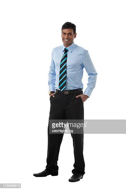 Male office worker smiling in office attire
