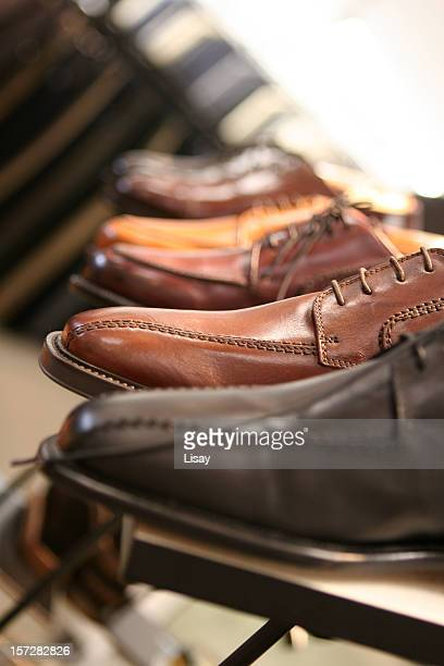 Male Oxford shoes are being displayed in a shoe store