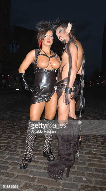 Male party revellers pose outside Marquee during Heidi Klum's 5th Annual Halloween Party October 31 2004 in New York City