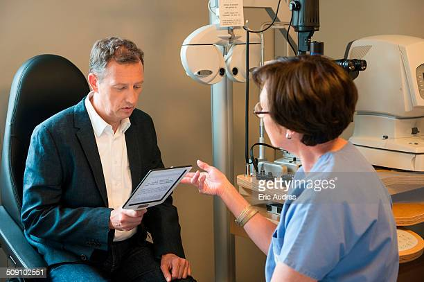 male patient having eye examination in an optometrist clinic - myopia stock photos and pictures