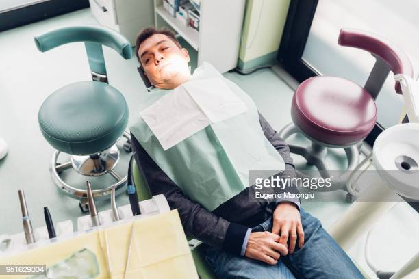 Male patient in dentist chair, elevated view