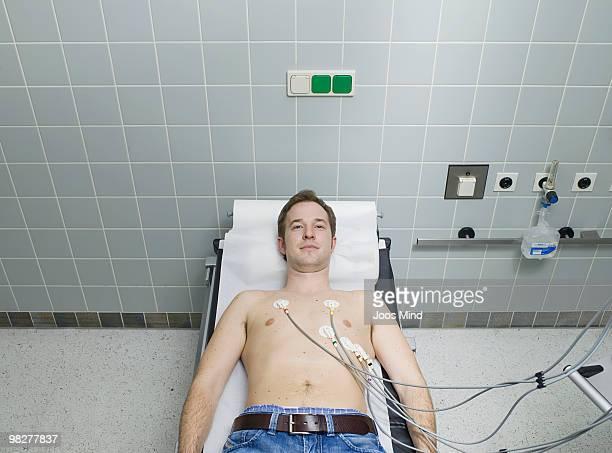 male patient receiving electrocardiogram