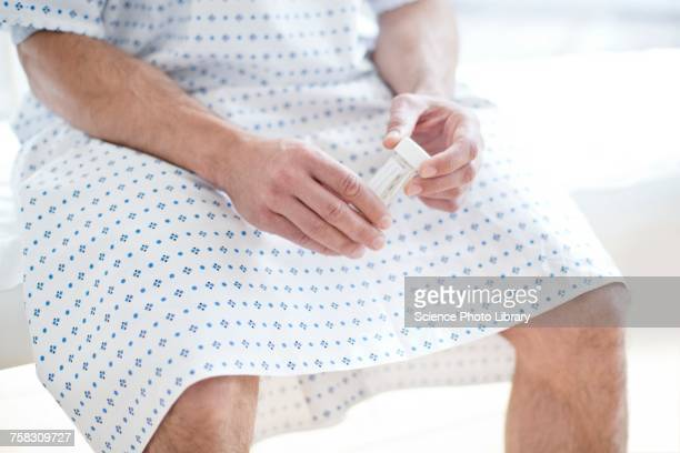 male patient with urine sample - urine sample stock photos and pictures