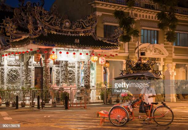 Male Pedicab Riders in front of Yap Kongsi Temple, George Town, Malaysia