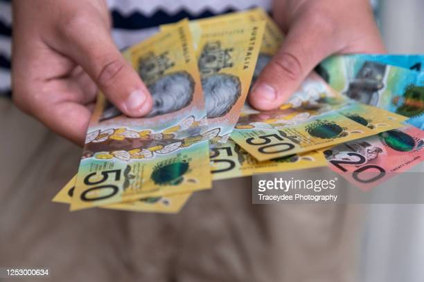 male person holding some australian currency - banknote stock pictures, royalty-free photos & images