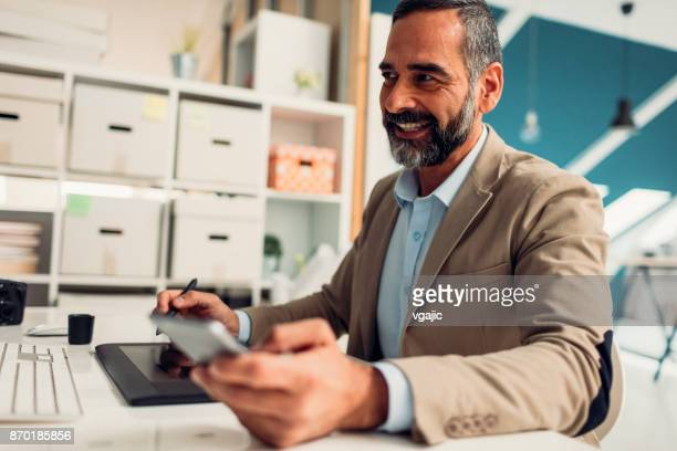 male photographer working in his office - retouched image stock photos and pictures