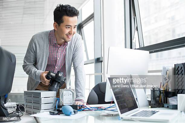 Male photographer working in office