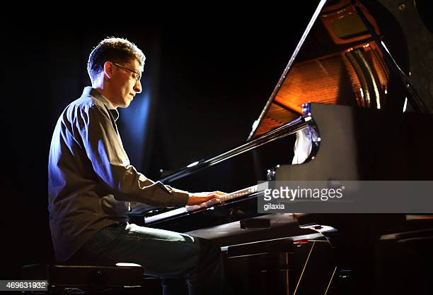 Male piano player in a concert.