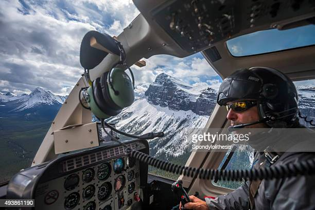 male pilot flying helicopter at assiniboine provincial park, canada - inside helicopter stock pictures, royalty-free photos & images