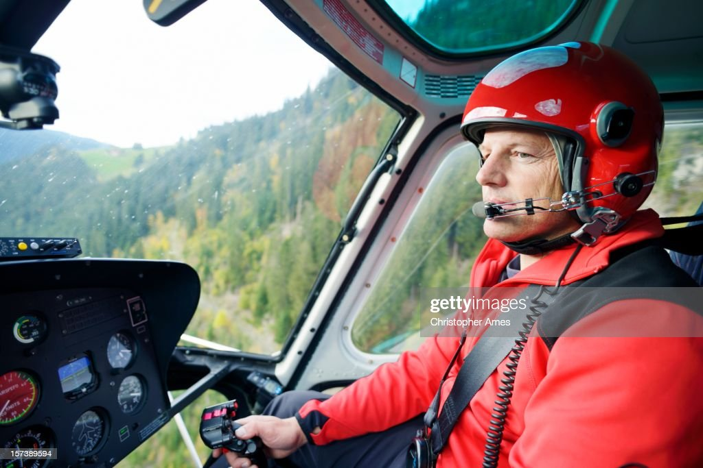 Male Pilot Flying Helicopter : Stock Photo