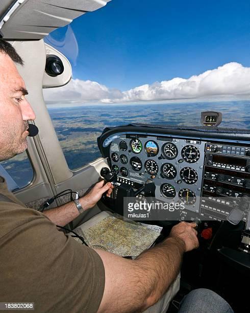 Male pilot navigating airplane