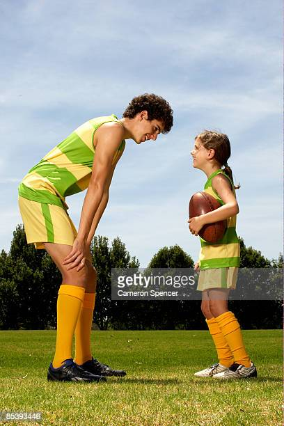 Male player giving advice to younger female player