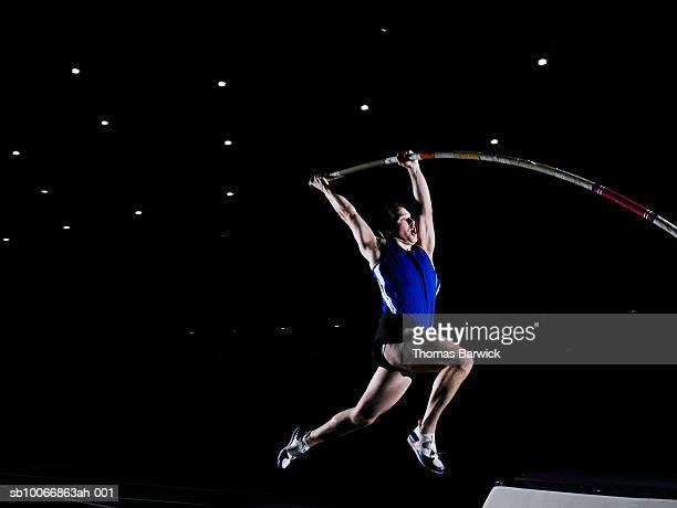 Male pole vaulter beginning vault
