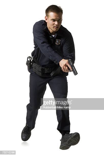 Male police officer pointing gun