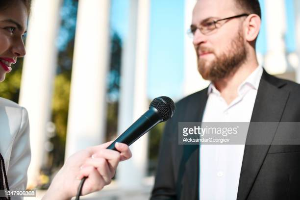 male politician concentrating during press conference - presidential candidate stock pictures, royalty-free photos & images