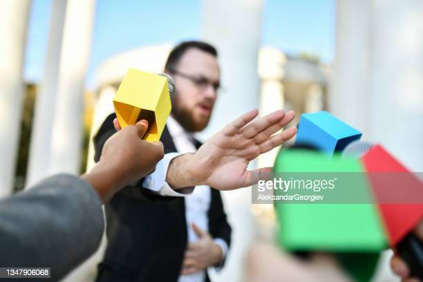 male politician refusing to give press statement outside - presidential candidate stock pictures, royalty-free photos & images
