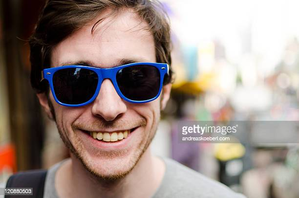 Male Portrait wearing blue sunglasses