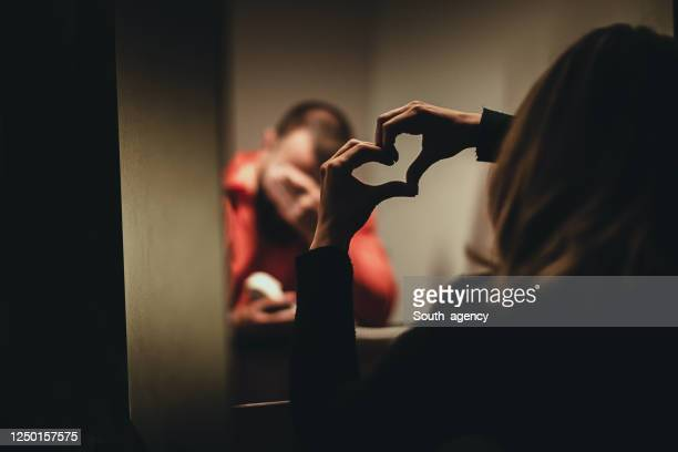 male prisoner sharing love with wife in prison visit room - murderer stock pictures, royalty-free photos & images