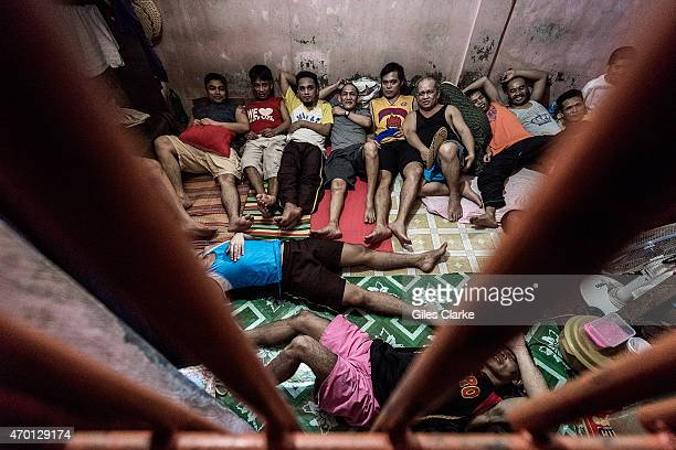 Male prisoners awaiting trial in the Isabela City police station Some have been in these holding cells for 7 years Their crimes range from petty...