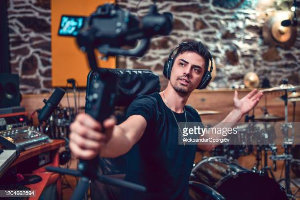 male producer making a vlog about his new studio - producer stock pictures, royalty-free photos & images
