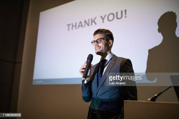 male professional giving presentation at convention center - launch event stock pictures, royalty-free photos & images