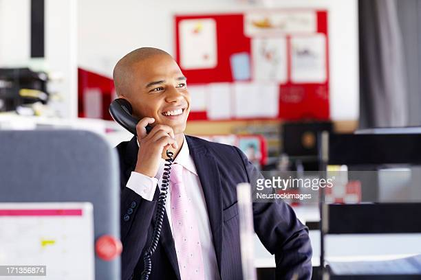 Male Professional On The Phone In Office