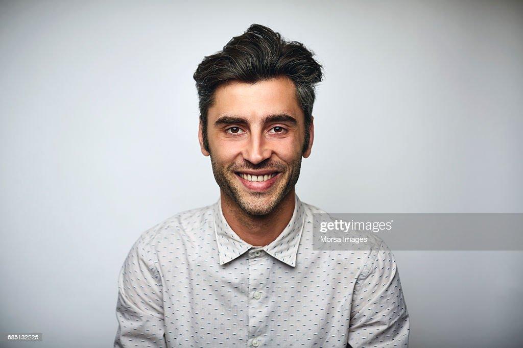 Male professional smiling over white background : Stock Photo