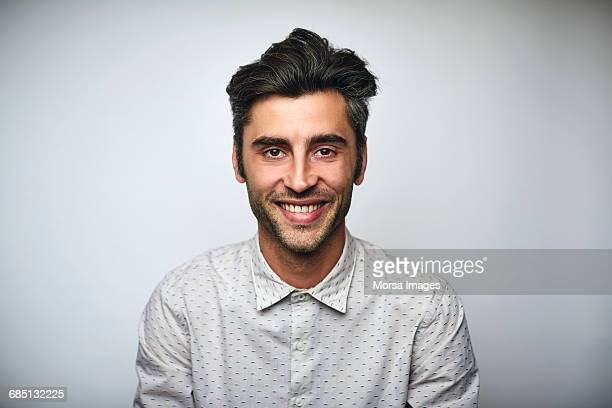 Male professional smiling over white background