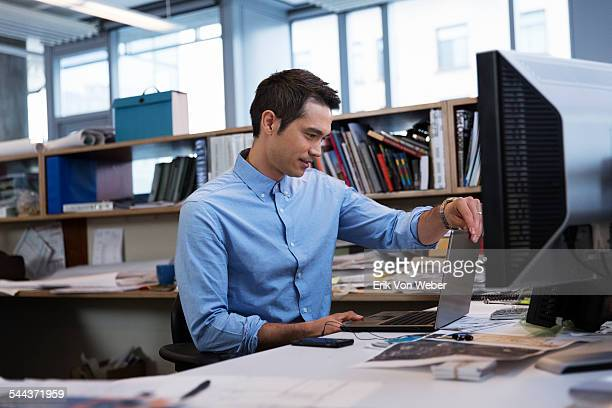 Male professional working in small modern  office