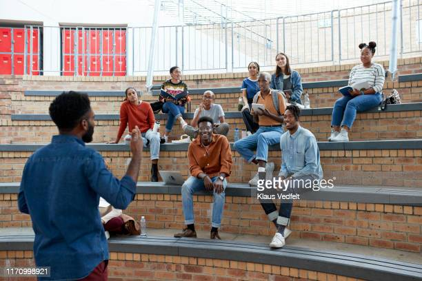 male professor teaching multi-ethnic students - 円形劇場 ストックフォトと画像