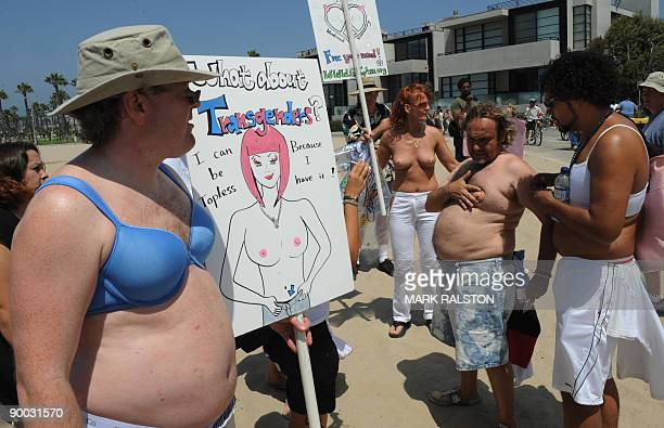 Male protesters wear bikini tops during 'National Go Topless Day' to honor Women's Equality Day at Venice Beach in Los Angeles on August 23 2009 The...