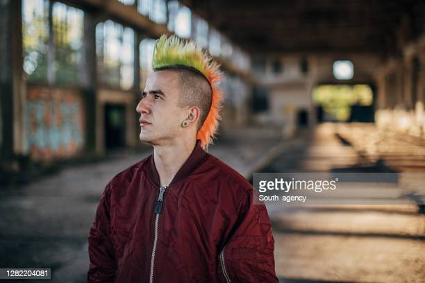 male punk person standing in abandoned building - bomber jacket stock pictures, royalty-free photos & images